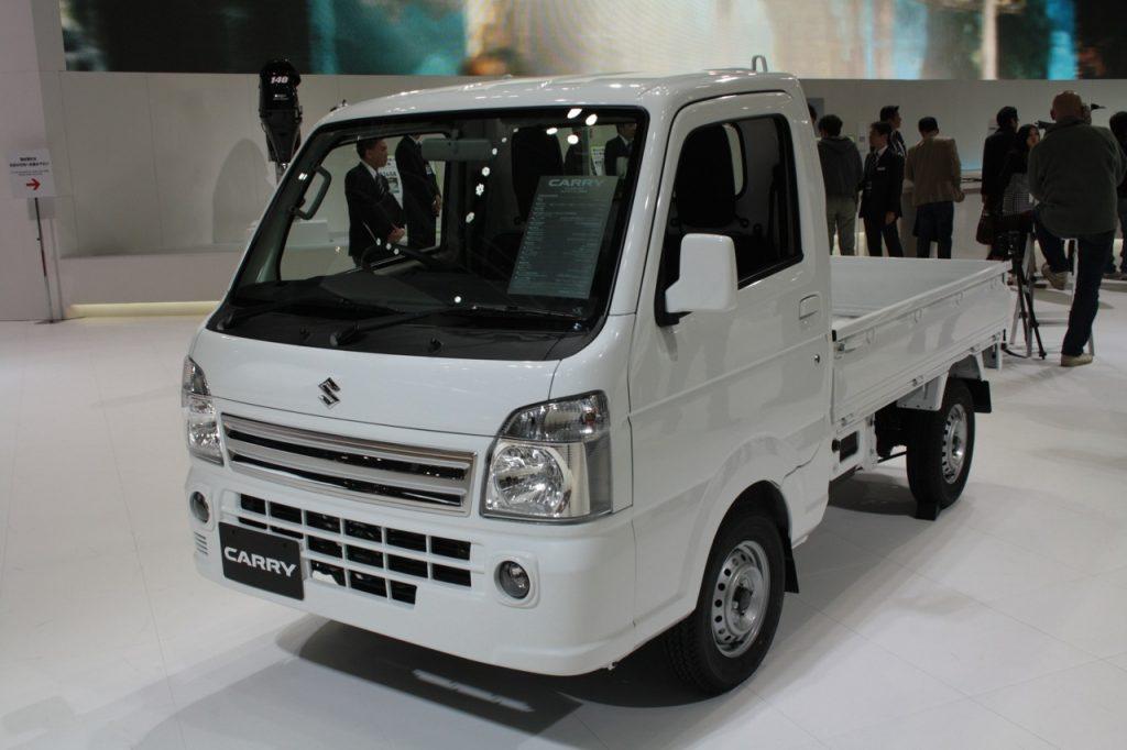 Suzuki Carry vs. Daihatsu Hijet vs. Subaru Sambar. This is a Suzuki Carry in white.