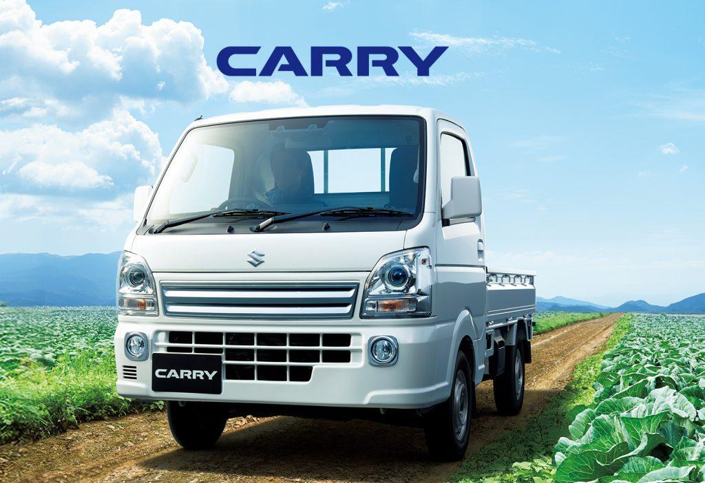 Suzuki Carry Mini Truck shown in a farm field.