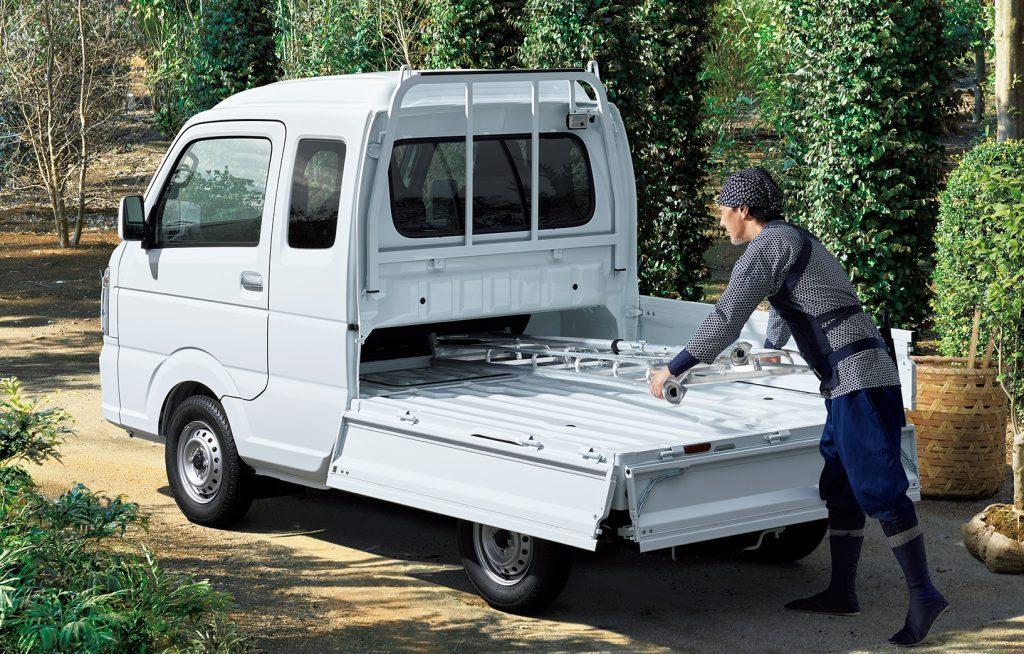 A Suzuki Carry Mini Truck being loaded.